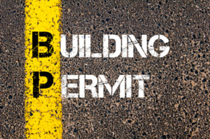 58608236 - concept image of business acronym bp building permit written over road marking yellow paint line